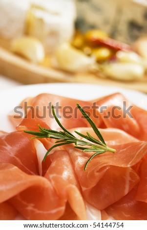 Slices of delicious prosciutto, traditional italian cured ham - stock photo