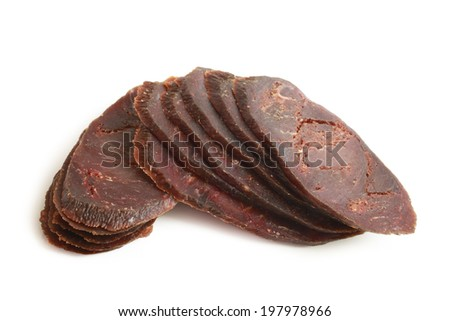 Slices of dried cured beef on white background - stock photo