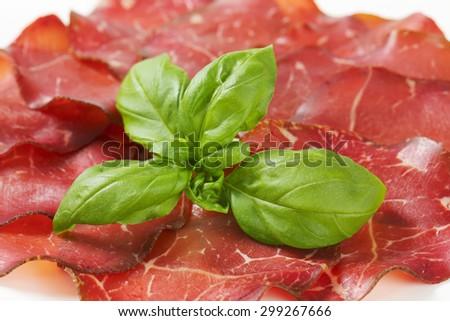 Slices of dried ham - prosciutto - stock photo