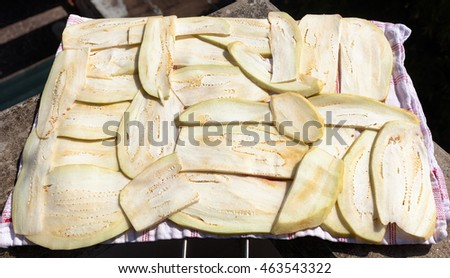Slices of eggplant to dry to the sun ready for frying. Recipe eggplant parmigiana.