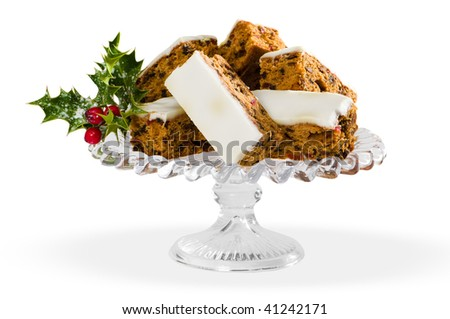 Slices of festive Christmas cake on glass comport, white background - stock photo