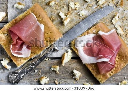 Slices of Focaccia Bread with Parma Ham - stock photo