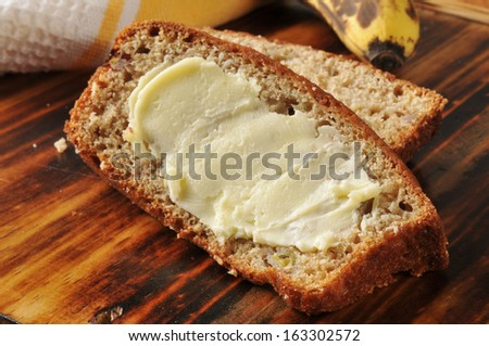 Slices of fresh baked buttered banana bread - stock photo