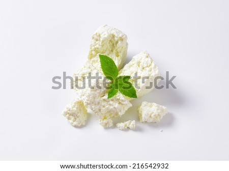 slices of fresh cheese on white background - stock photo