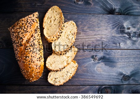 Slices of fresh crispy baguette with sesame. Top view - stock photo