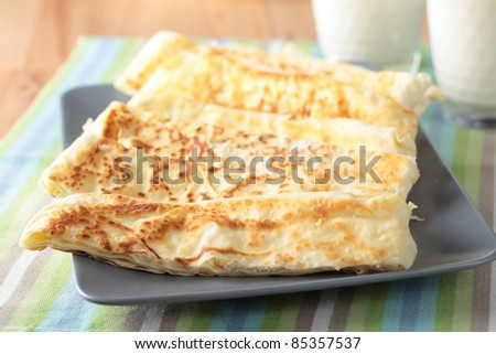 Slices of gozleme with cheese on a plate - stock photo