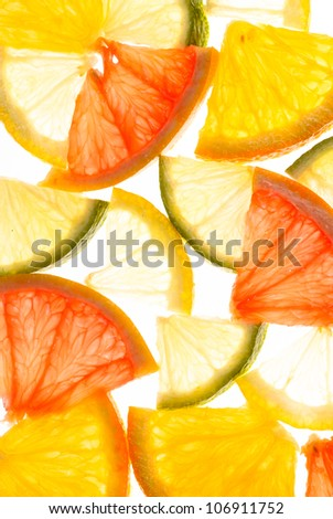 Slices of grapefruit, lemon, lime and orange as a background - stock photo