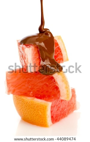 slices of grapefruit with pouring chocolate - stock photo