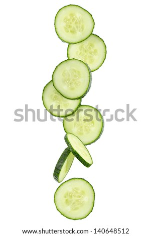 Slices of green cucumber isolated on white - stock photo