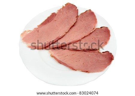 slices of ham in white plate isolated over white - stock photo