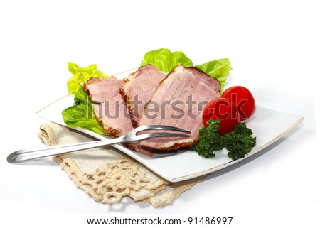 slices of ham on white background