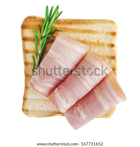 Slices of ham with rosemary - stock photo