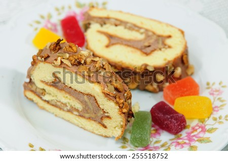Slices of homemade Swiss roll - stock photo