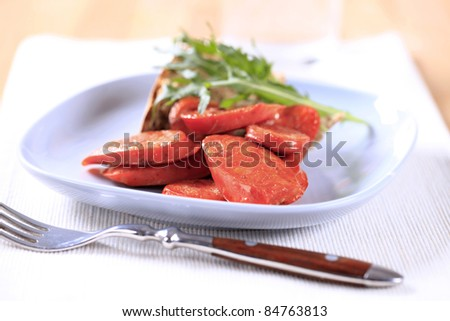 Slices of Italian sausage with red pepper flavor