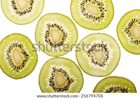 Slices of kiwi covered with water - stock photo