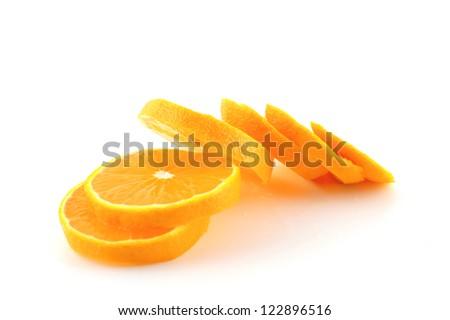 Slices of orange tangerine over white - stock photo