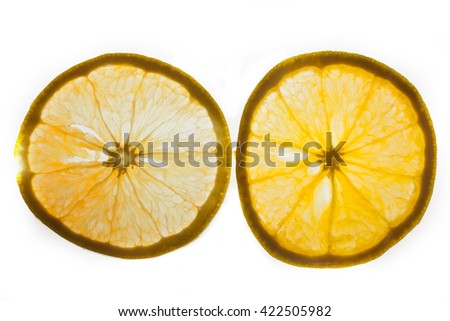 Slices of orange with a beautiful back light isolated on white background.