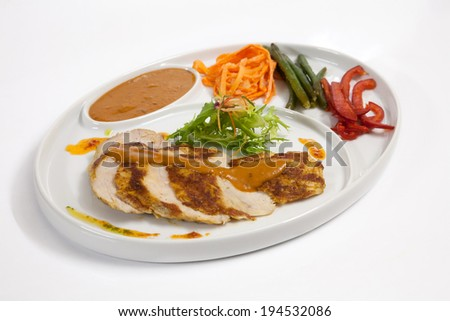 Slices of roast meat with vegetables on a plate