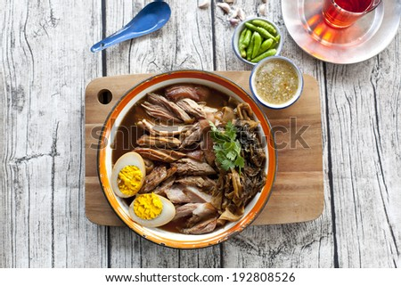 slices of roast pork trotters that typically accompanies plain rice - stock photo