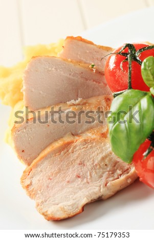 Slices of roasted chicken breast - stock photo