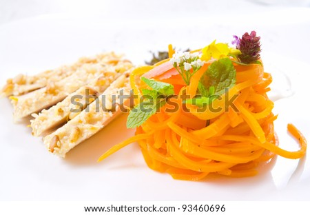 Slices of roasted chicken with carrot garnish - stock photo
