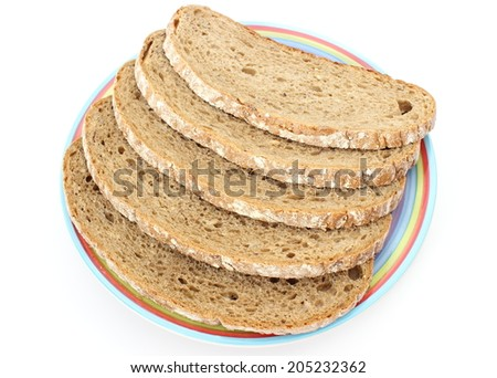Slices of rye bread lying on a colorful plate