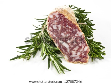 Slices of Salame and italian rosemary  on white background - stock photo