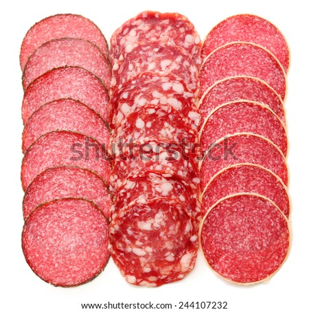 Slices of salami isolated on white - stock photo