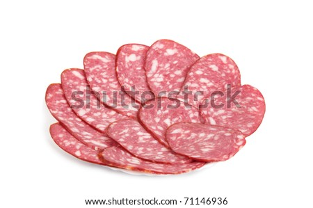 Slices of smoked sausage on a plate isolated on white background - stock photo