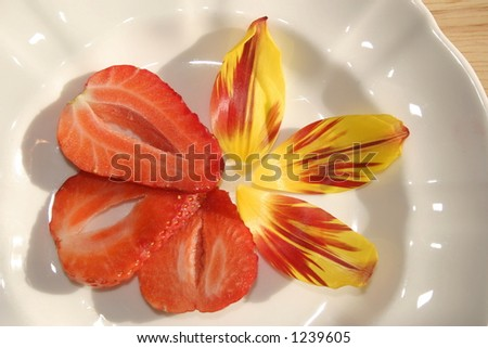 slices of strawberry and petals for decoration - stock photo