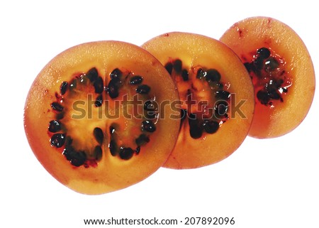 Slices of tamarillo fruit, close-up - stock photo
