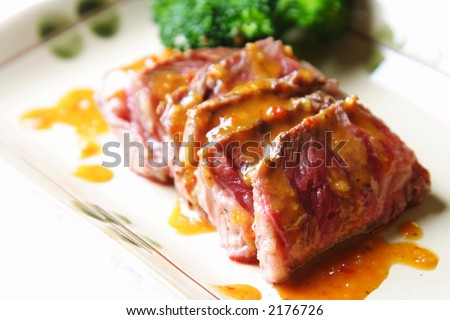 Slices of tender beef with peanut sauce and broccoli - stock photo