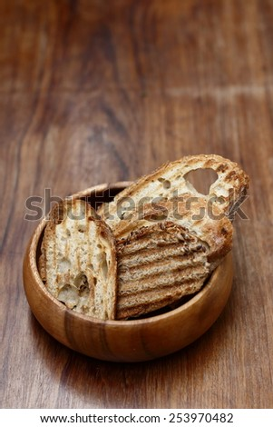 slices of toast bread and old wooden table