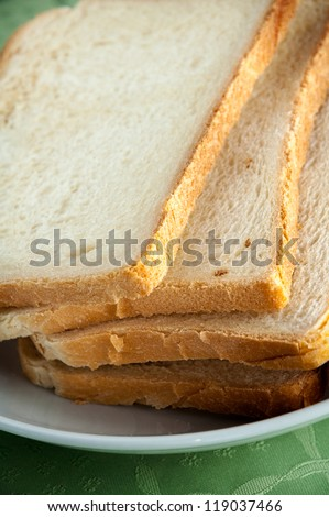 Slices of toast bread on a white plate - stock photo