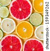Slices of various citrus fruits - stock photo