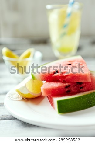Slices of watermelon on a plate - stock photo