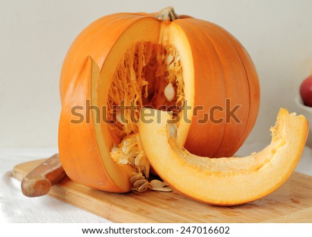Slicing pumpkins for soup or pie - stock photo