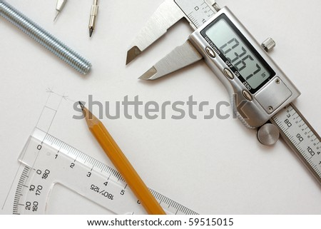 Slide caliper, screw, protractor, pencil and drawing - in inches - US - stock photo