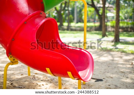 Slide from crawl construction on modern kids playground - stock photo