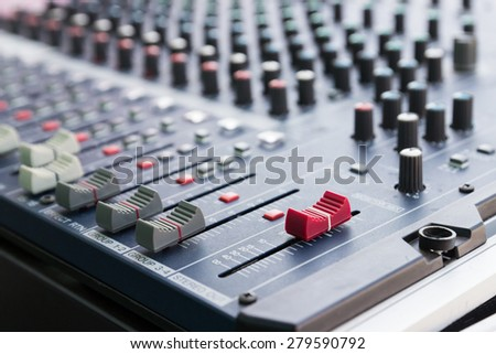 slider and knob of sound mixer console - stock photo