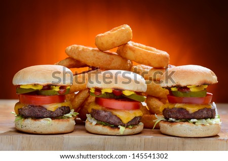 Sliders with Onion Rings - stock photo