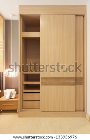 sliding doors wardrobe furnishing in small room. - stock photo