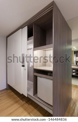 sliding doors wardrobe in hotelroom. - stock photo