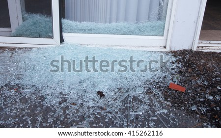 Sliding glass door that has been shattered by a criminal
