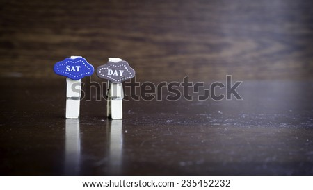 Slightly defocused and close-up short form for SATURDAY word on clothes peg. Concept of day in a week. - stock photo