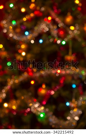 Slightly defocused real vertical Christmas background with small sized colorful bokeh