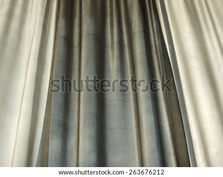 Slightly translucent curtain of highest quality pure silk  - stock photo