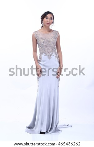 Slim and Healthy Female Model in Fashion Dress Crystal evening gown, full body