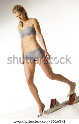 Slim attractive girl with shoe-stopper steeplechase equipment - stock photo