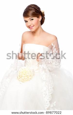 Slim beautiful woman  wearing luxurious wedding dress. Bride - stock photo